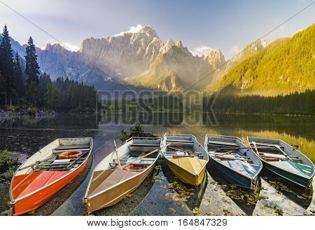 misty morning on the alpine lake laghi di Fusine Italy