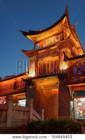 Night View Of Traditional Chinese Wooden Building In Lijiang