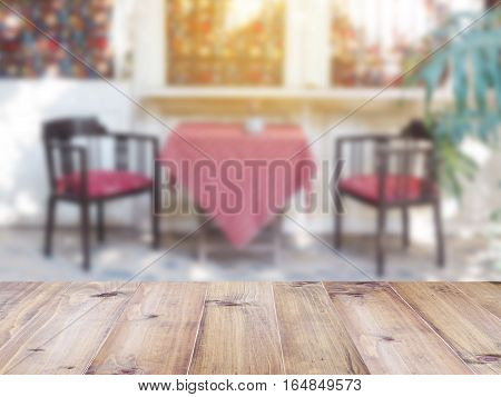 Perspective wood and blurred outdoor cafe background. product display template.