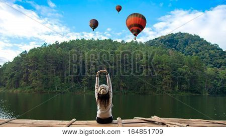 Women are siting and seeing the balloon on the terrace at resort on enjoy and relax with the outside nature