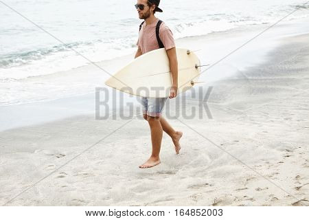 Sports, Vacations, Style And Fashion Concept. Fashionable Young Male Model Carrying White Surfboard
