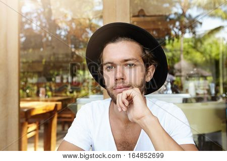 Headshot Of Fashionable Attractive Young Student With Stylish Beard Wearing Black Hat And V-neck Shi