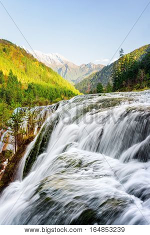 Fantastic View Of The Pearl Shoals Waterfall Among Mountains