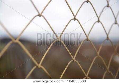 Chain link grid fence close view prison concept