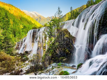 Scenic View Of The Pearl Shoals Waterfall Among Woods At Sunset