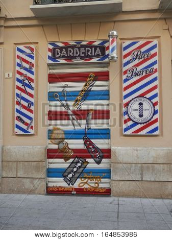 Malaga Spain - January 9 2017: Barber shop with red white and blue signage
