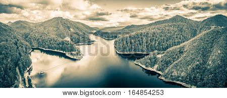 Beautiful Cethana Lake And Surrounding Forest Aerial Panorama In Black And White