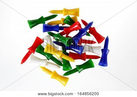 Pile of Golf Tees on White Background