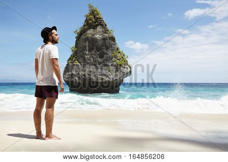 Tourism, Travel And Holidays Concept. Young Caucasian Male Model Wearing Black Hat And Casual Clothi