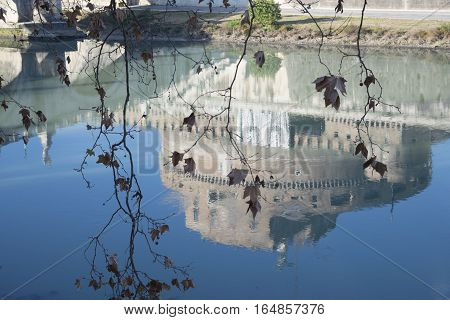 Saint Angel Castel in Rome reflected in the water of the Tiber river