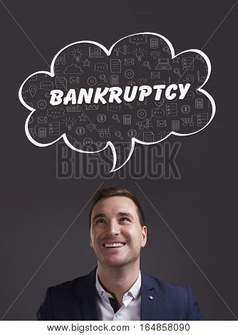 Business, Technology, Internet And Marketing. Young Businessman Thinking About: Bankruptcy