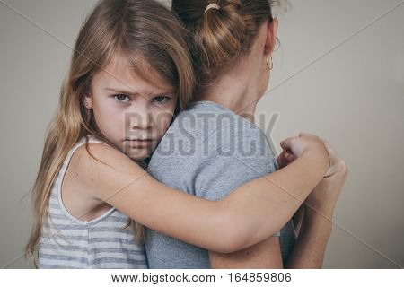 Sad Daughter Hugging His Mother At Home.
