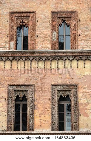 Old window in palace on Piazza Sordello The historic city center of Mantova Lombardy .Italy