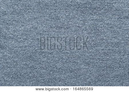 woven texture of woolen fabric or yarn closeup for a background or for wallpaper of silvery color
