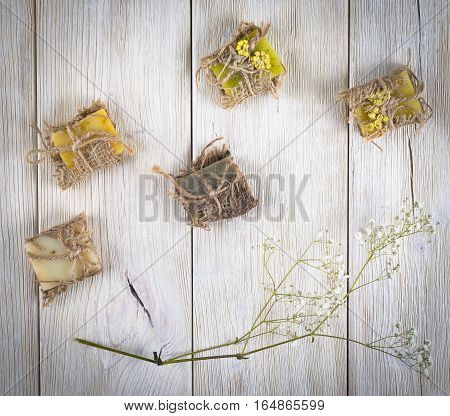 Handmade natural soap on light wooden background
