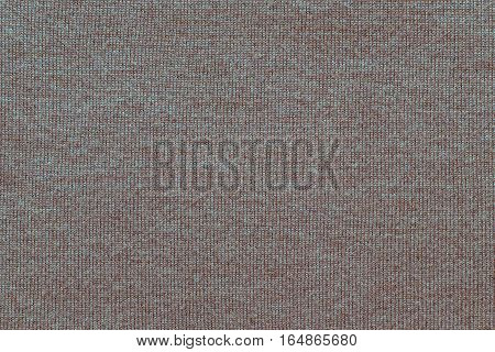 woven texture of woolen fabric or yarn closeup for a background or for wallpaper of speckled color