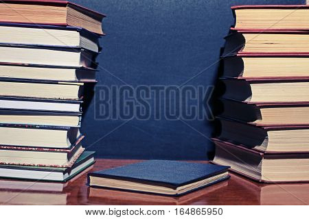 books on wooden deck tabletop against grunge board copyspace for your text