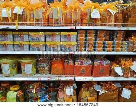 CHIANG RAI THAILAND - NOVEMBER 29 : various brand of buddhist products for rituals in packaging for sale on supermarket stand or shelf on November 29 2016 in Chiang rai Thailand.