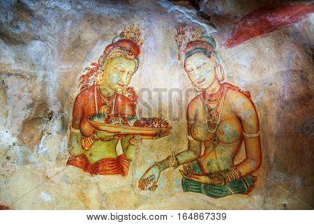 Frescoes in Sigiriya Lion Rock. Apsaras. Sri Lanka.