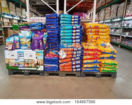 CHIANG RAI THAILAND - NOVEMBER 29 : various brand of dog food packaging for sale on supermarket stand or shelf on November 29 2016 in Chiang rai Thailand.
