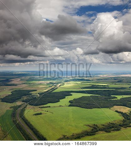 Aerial view of the countryside with fields and road in summer.