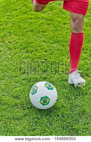 Soccer striker kicking the ball, toned image