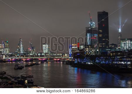 London, Uk - December 13, 2016: London Skyline At Night With Light Show From The Shard Skyscrapper A