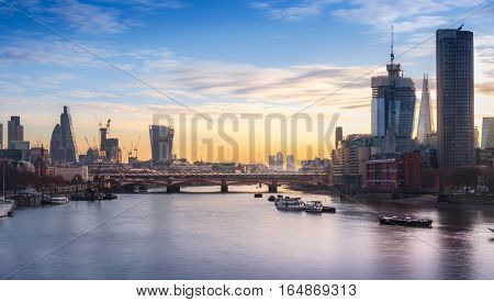 London, UK - December 15, 2016: London cityscape and skyline at sunrise from Waterloo bridge
