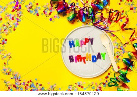 Happy Birthday Party or Carnival background or Party concept with fun articles and party accessories plate with Candles view from above. Top view.