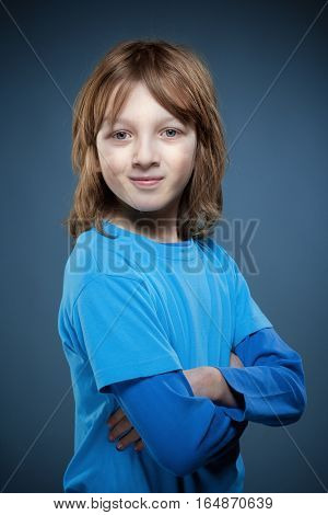 Portrait of a Boy with Blond Hair in Blue Top
