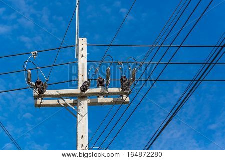 High Voltage Power Pole With Wires Tangled.