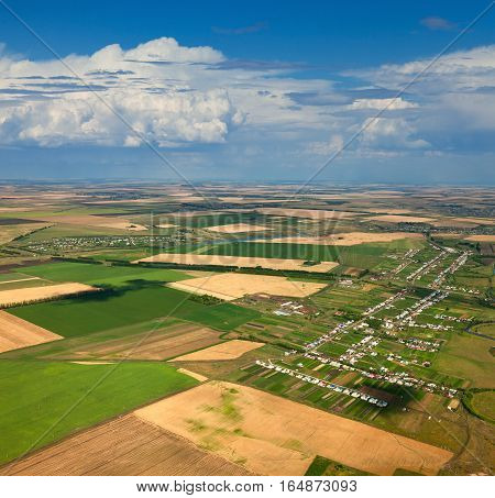 Aerial view of the countryside with fields of crops in summer.