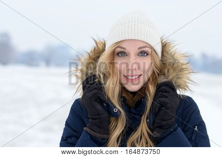 Pretty Blond Teenage Girl With A Friendly Smile
