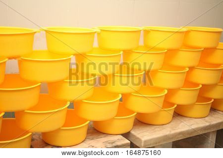 Many Yellow Wooden buckets for a bathhouse .
