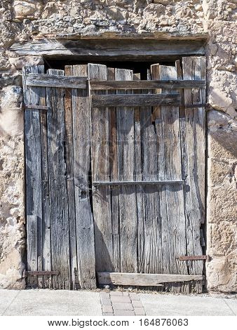 Old wooden door weathered by years in a medieval village