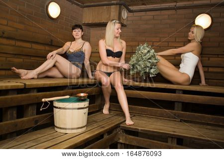 GRODNO BELARUS - DEC 17: girls with a broom in a sauna bathhouse steamed in Grodno Belarus December 17 2014