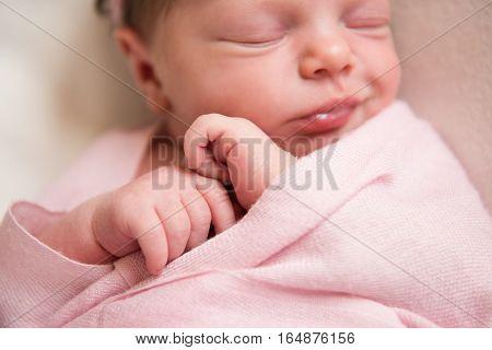 Newborn baby girl asleep on a blanket. Selective focus