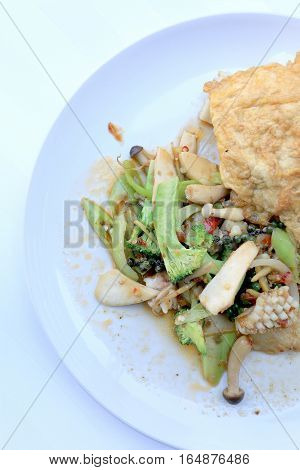 Stir Fried Spicy Seafood With Black Pepper And Thai Style Omelette With Rice On White Dish,  Thai Sp