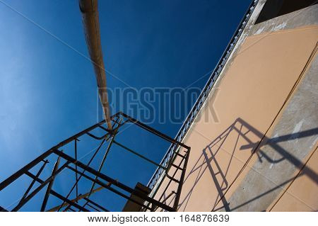 The steel scaffolding for painting a building.