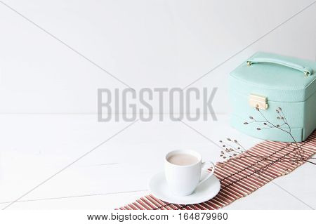 Minimal elegant composition with turquoise box and coffee cup for blogs, shops and social media