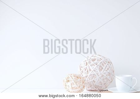 Minimal elegant composition with rattan balls and coffee cup for blogs, shops and social media