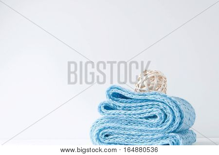Minimal elegant composition with blue scarf and rattan ball for blogs, shops and social media