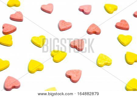 Heart Shaped Healthcare Pills On White Background