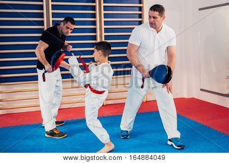 Tae kwon do instructors with little boy