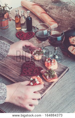 Bruschetta. Woman Is Cooking Romantic Dinner. Toned Photo. Valentine Day. Love.