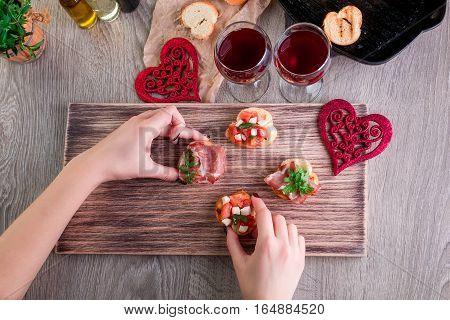 Bruschetta. Woman Is Cooking Romantic Dinner. Top View. Valentine Day. Love.