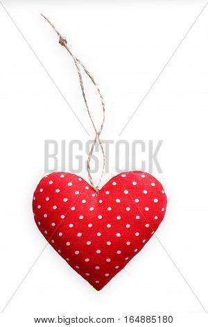 Red spotted sewed pillow in heart shape, diy homemade isolated on white background. Valentine day mockup. Lovers holiday symbol