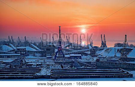 Dockyard winter sunset through the welding glass. Ruse city, Danube river, Bulgaria.