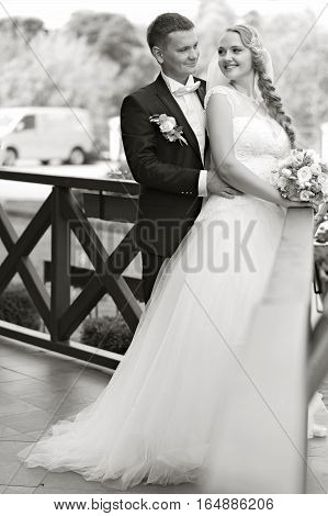 Happiest moments together. Cheerful young loving bride and groom on their wedding day