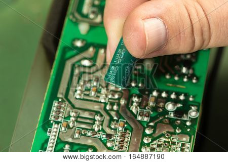 Technician repair and replace capacitor in circuit board